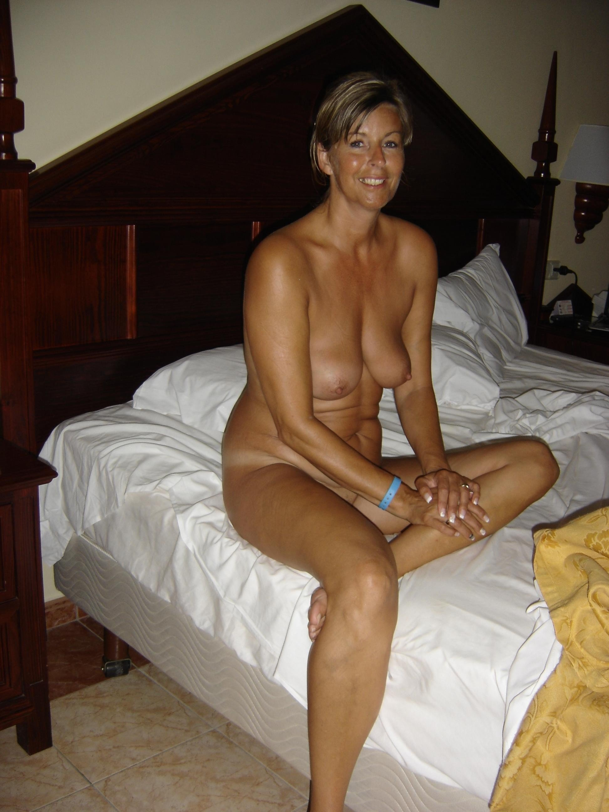Naked milf on bed