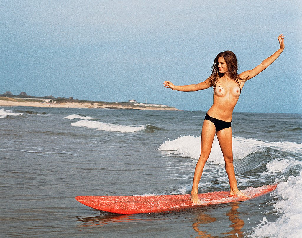 Naked surfer felicity palmateer makes waves with performance art