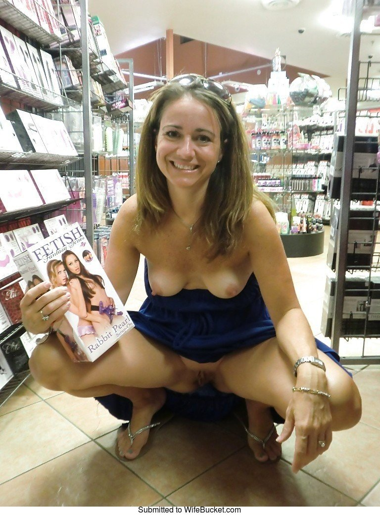Wife nude in store