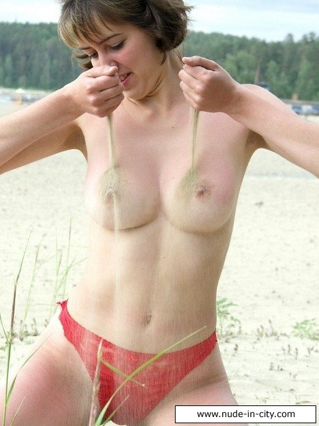 Naked matures at the beach #1