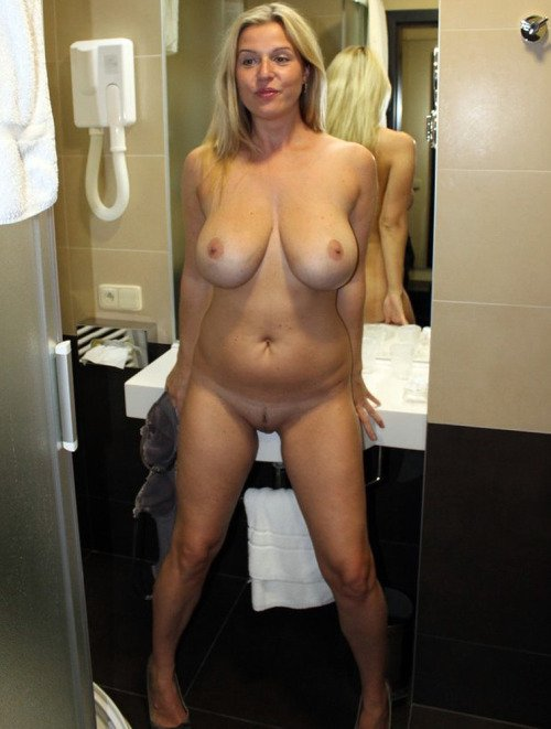 Blonde with big fake tits #9