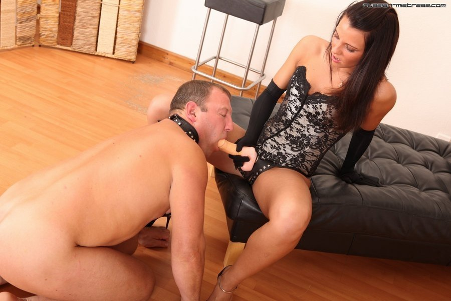 Mistress forcing slave to suck a cock