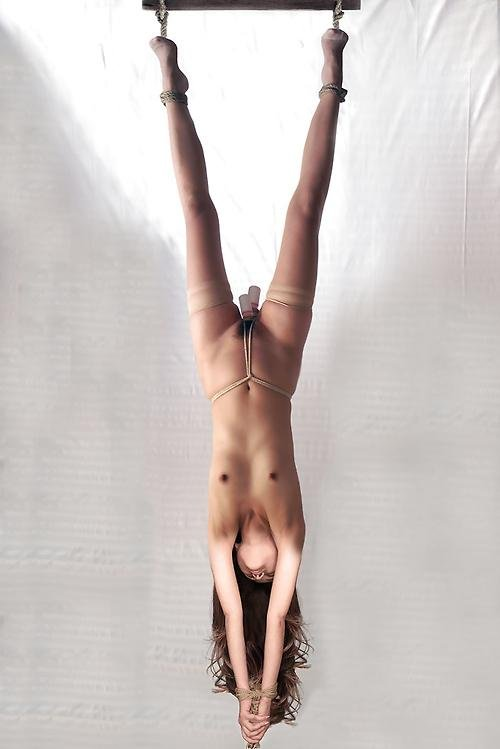 Tied naked and upside down