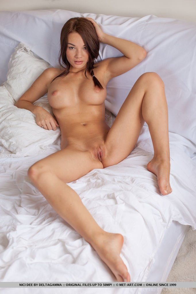 Naughty hottie raises her long legs and begins feeling how piece of meat