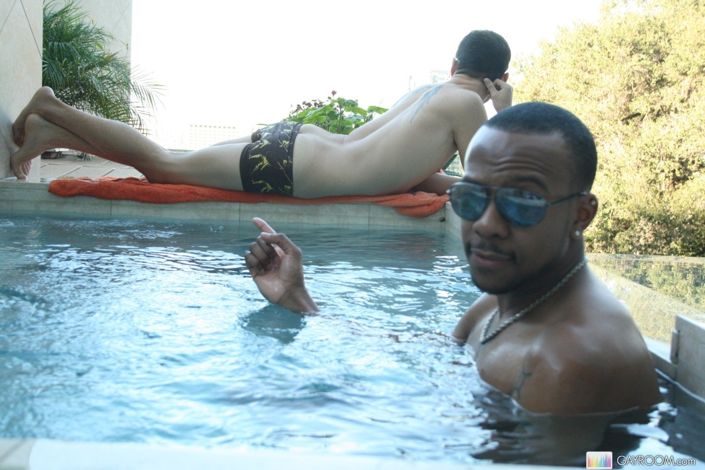 Interracial gays in the swimming pool