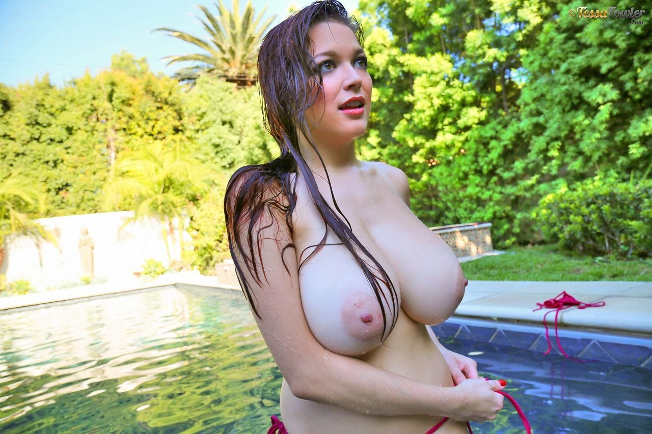 Mature woman shows off her tits outside