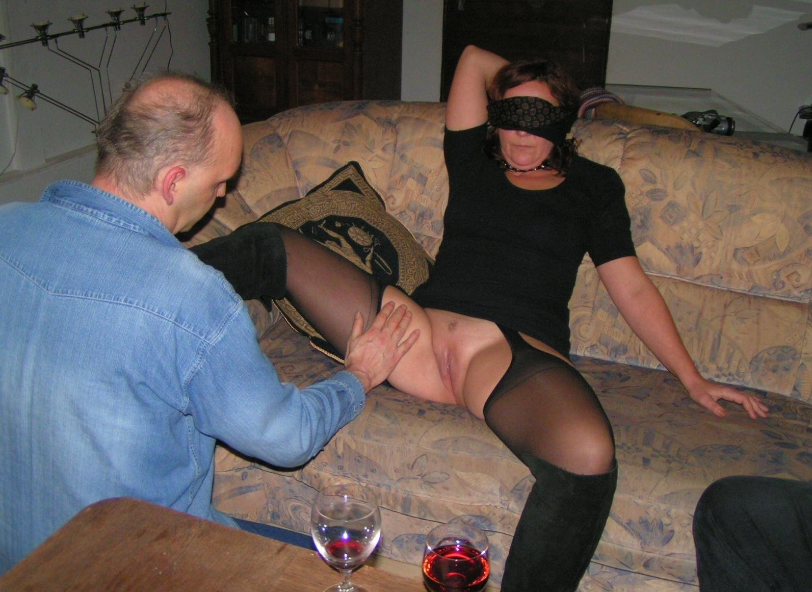 Wife teasing husbands friends while out