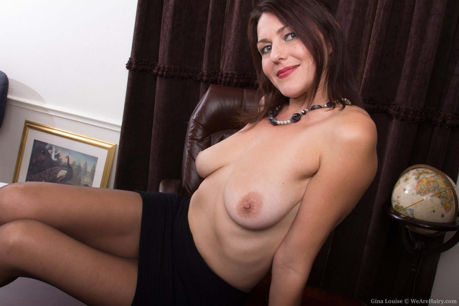 gina louise is a mature & busty all-natural beauty. she spreads her