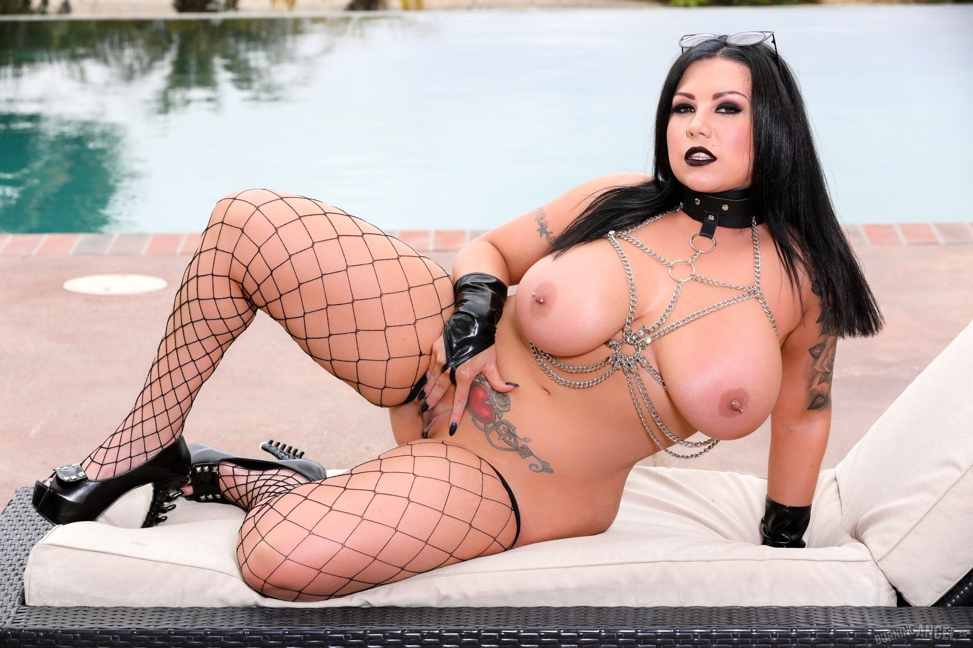 Goth chick with small tits strips