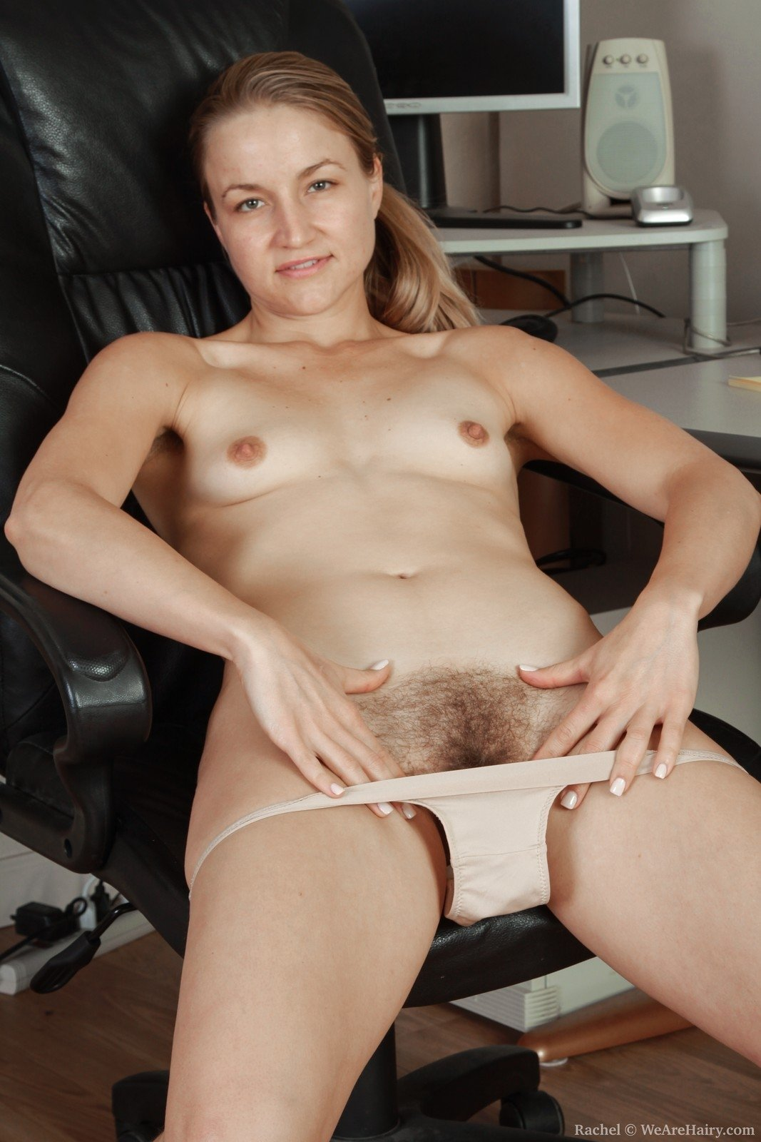 Rachel Sits In Her Office Chair Bored Without Any Work To -3755