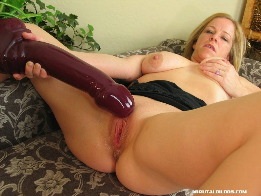Tight pussy and massive dildo