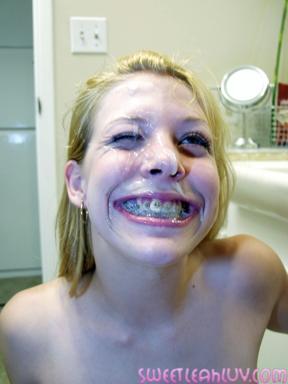 Girl with braces gets cum facial