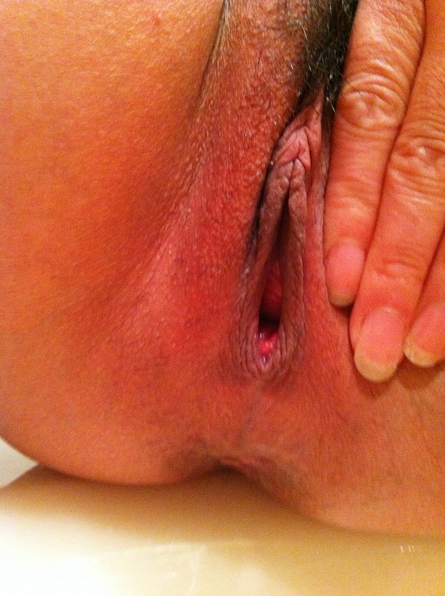 woman licking her own vagina