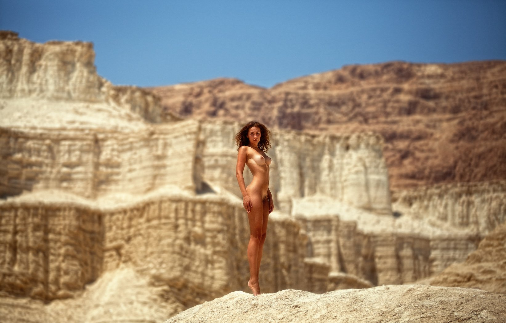 Nude in landscape photograph by ton dirven
