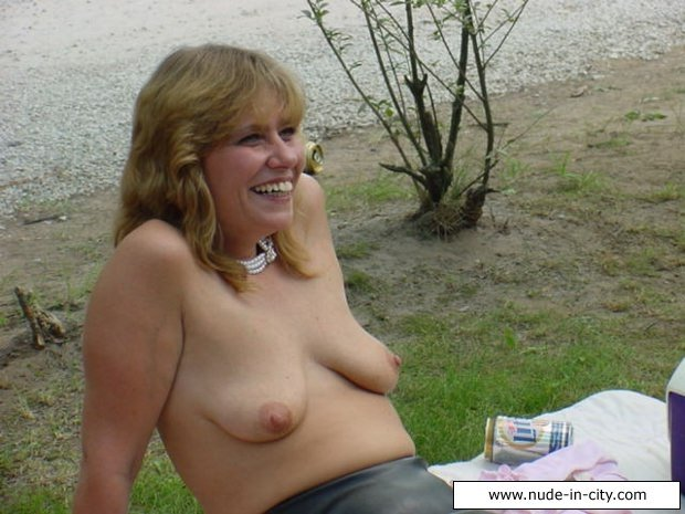 Mature handjob on the beach #8