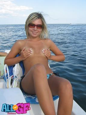 The amusing nude beauties on a boat