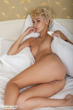 image Blond haired slut plays with her hot body
